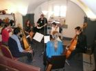 Vivien 'organising' six viols players<br />in another Skittle Alley scratch band